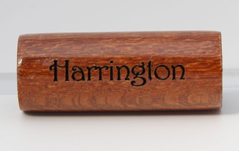 Harrington font example on Leopard Wood