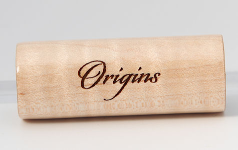 Origins font example on Curly Maple